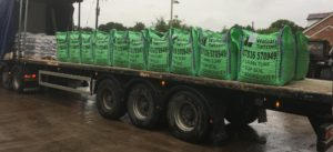 HGV filled with bulk bags containing stone
